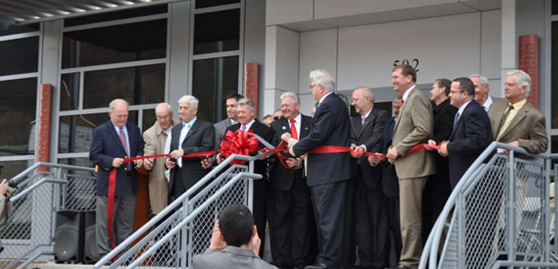 camtran-history-building-2-cutting-ribbon